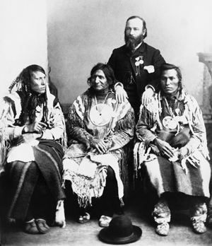 Picture of Jean L'Heureux circa 1880 with three Blackfoot Confederacy chiefs